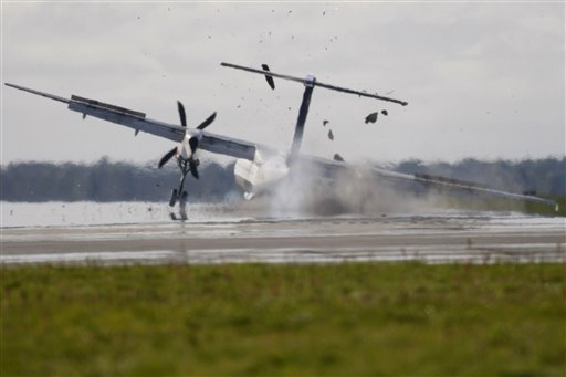 SAS, turboprop carrying 73 people caught fire Sunday after its right landing gear collapsed during an emergency landing at Aalborg's airport in western Denmark. Five people were hurt during the evacuation.